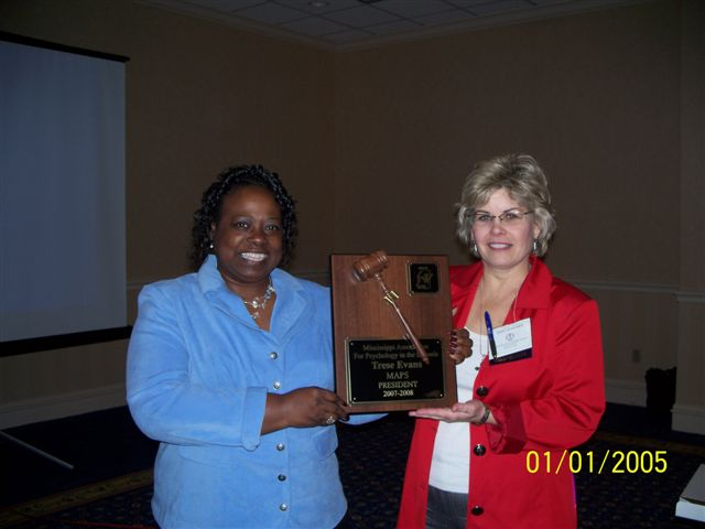 Presentation of President\'s plaque. Terry M., President Elect, incoming President Trese E., out going President 2009