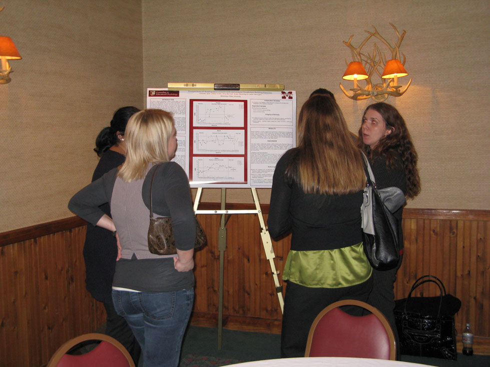 Erin Gray & Jodi Dollar discuss poster with students