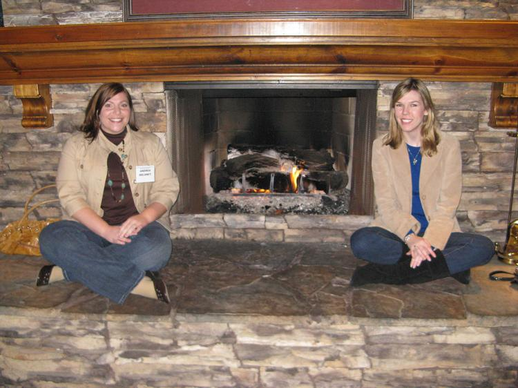Andrea Delaney and Missy Flinn warm by the fire